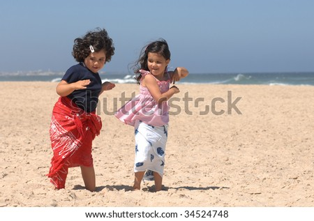 cute little girls dancing on the beach