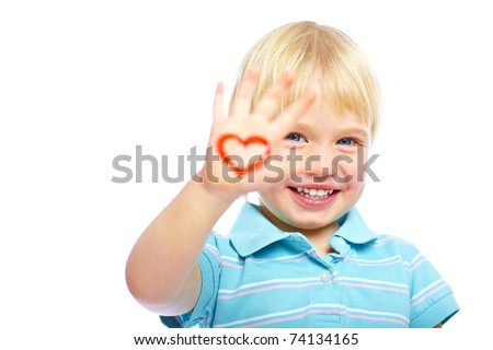 Cute little kid with painted heart shape on his hand