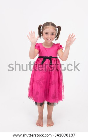 Cute little ladt showing hands up gesture in pink dress