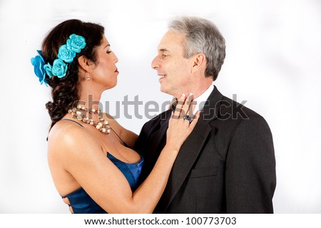 Cute mature romantic couple, with man in suit and tie and the woman in a , blue, formal dress