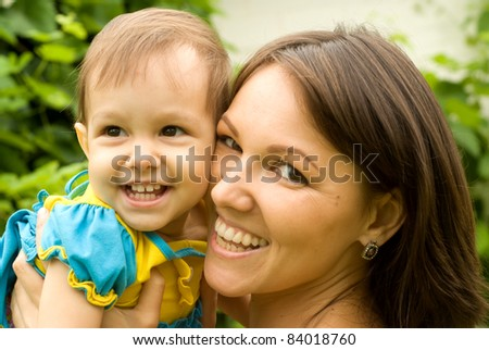 cute mom with her daughter at nature