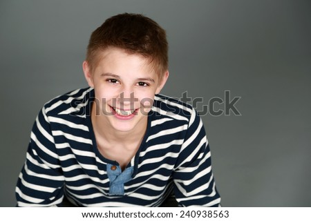 cute preteen blond boy with nice teeth smiling