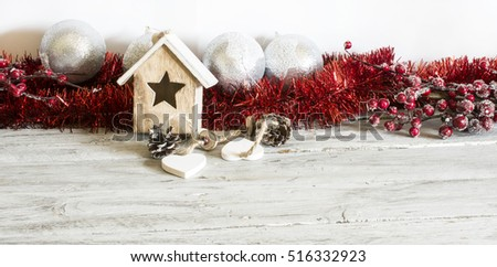 Cute red colored Christmas decoration. Horizontal indoors shot.