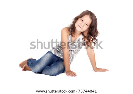 cute smiling curly little girl dressed casual