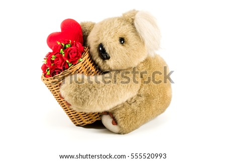 Cute teddy bear carrying bamboo basket full of red roses and heart on white background