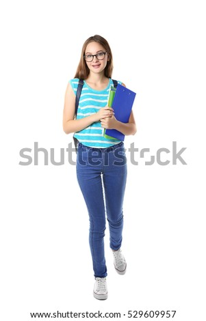 Cute teenage girl holding papers on white background