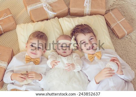 Cute toddler boys and little girl with gift boxes