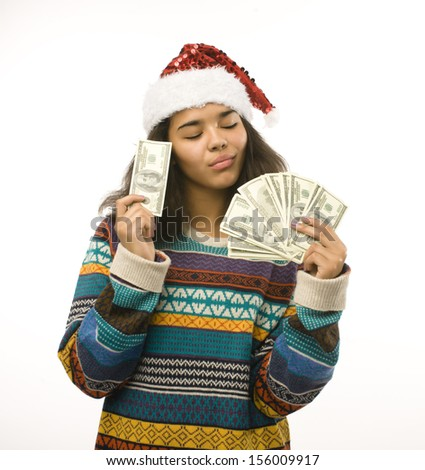 cute young girl in santas red hat with money isolated