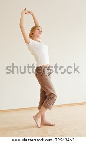 cute young girl walking and stretches at home