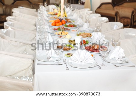 cutlery on the white banquet table in restaurant
