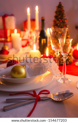 Cutlery with red ribbon on the holiday table
