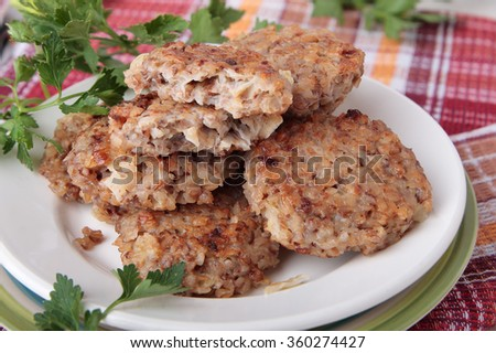 Cutlets of buckwheat with onions and parsley on plate