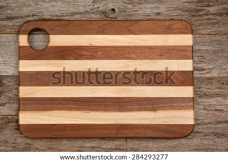 Cutting Board Resembling A Flag Placed On Barn Wood Table Top With Copy  Space
