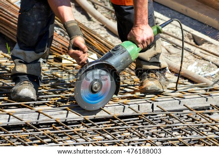 Cutting steel with angle grinder in reinforcing iron site