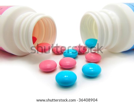 cyan and magenta pills on a white background