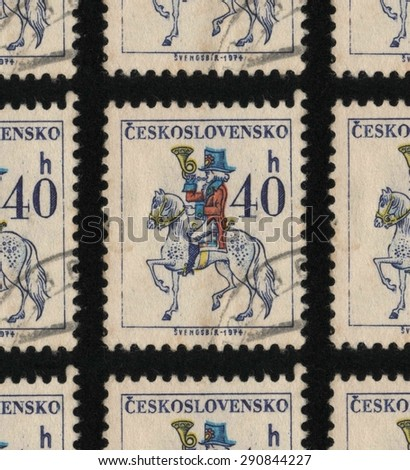 "CZECHOSLOVAKIA - CIRCA 1974 - 1979: A used postage stamp printed in Czechoslovakia from the ""Czechoslovak Postal Services"" issue, showing a postal worker on a white horse."