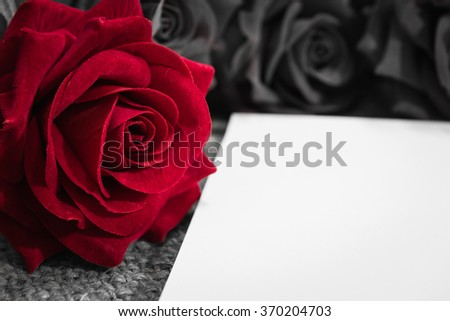 Daily note-book of love and red rose on a wooden background. for valentine day