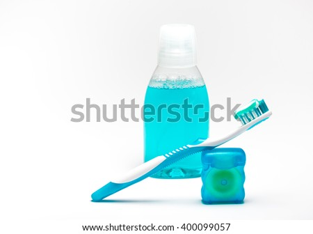 Daily oral hygiene - toothpaste, dental floss, toothbrush and mouthwash. Complex of cleaning products for your teeth and rinse of mouth, isolated on white background.