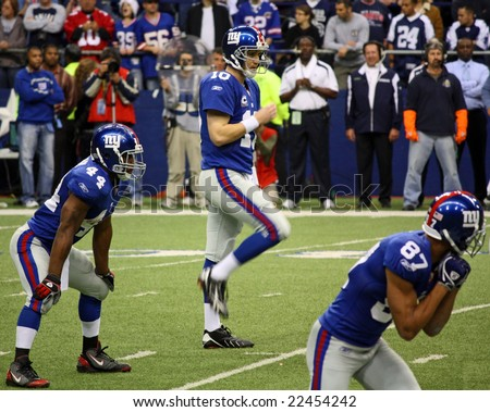 DALLAS - DEC 14: Sunday, December 14, 2008. NY Giants Quarterback Eli Manning prepares to receive the snap from center during a game with the Dallas Cowboys. Taken in Texas Stadium.