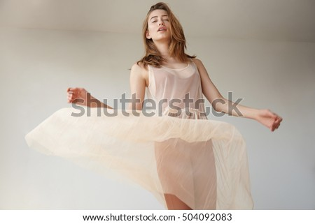 dancing caucasian woman with flying dress