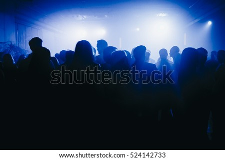 Dancing Crowd.  image of silhouette of people dancing at party.