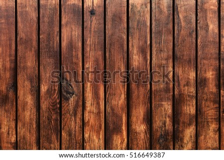 Dark brown wood panels texture and background