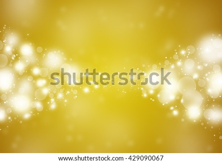 Dark Gold sparkles glitter defocused rays lights bokeh abstract holiday background.