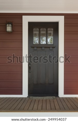 Dark Stained Wood Front Door With White Surrounding Door Frame On Red  Country Style Exterior