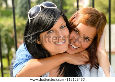 Daughter hugging her mother outdoors happy loving teen bonding affectionate