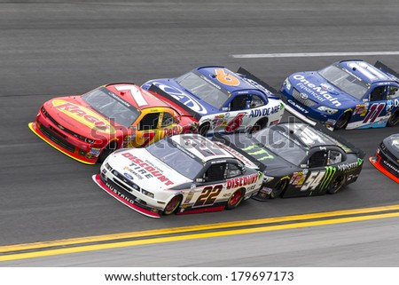 Daytona Beach, FL - Feb 22, 2014:  Regan Smith (7) holds off rest of the field to win the DRIVE4COPD 300 at Daytona International Speedway in Daytona Beach, FL.