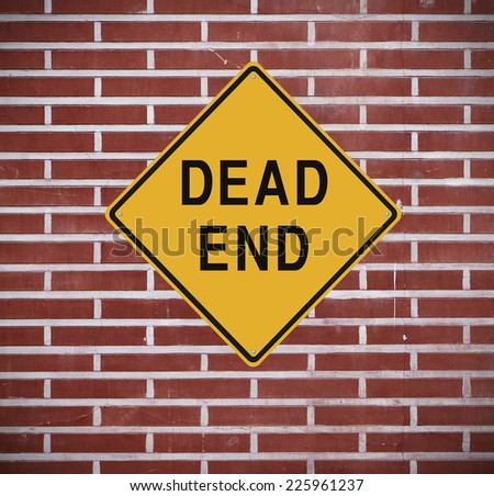 Dead end sign mounted on a wall