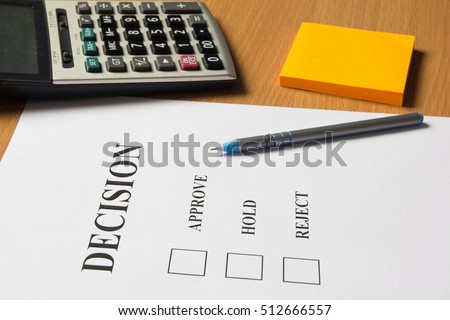 Decision paper (approve, hold, reject) with pen, calculator, note