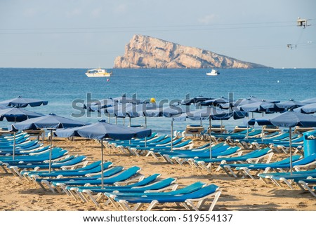 Deckchairs ready for tourists on Benidorm beach resort,  Costa Blanca, Spain