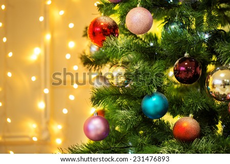 Decorated Christmas tree on blurred backgroun
