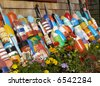 Decorative buoys by the side of a beach house - stock photo
