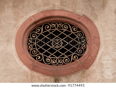 Decorative ironwork pattern on oval window opening in Festung Marienberg, Wurzburg, Bavaria, Germany, along the Romantic Road