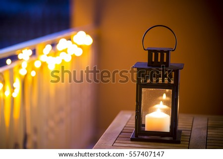 Decorative lanterns lit on the table.