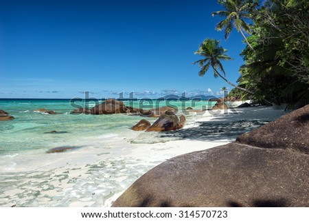 Deep blue sky and beautiful beach with large stones / outdoors photography of picturesque Seychelle islands