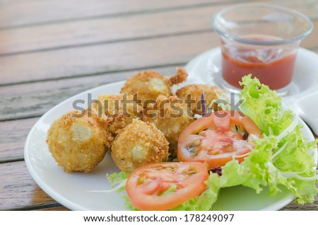 Deep Fried Potato Croquettes  served with tomato sauce  and fresh vegetable
