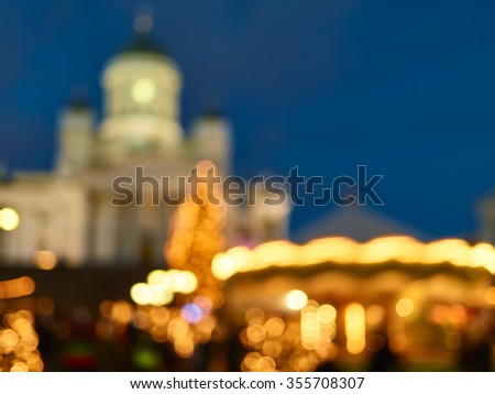 Defocused background image, The Christmas Market in Senate Square, a Carousel and the Helsinki Cathedral, Finland
