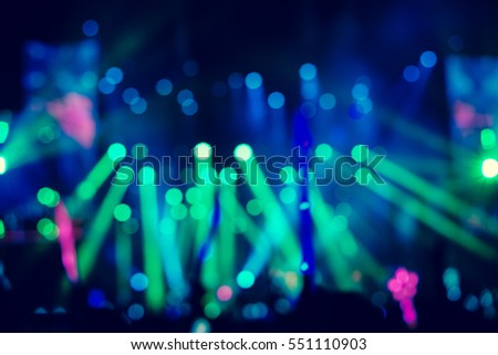 Defocused entertainment concert lighting on stage, blurred disco party and Concert Live.