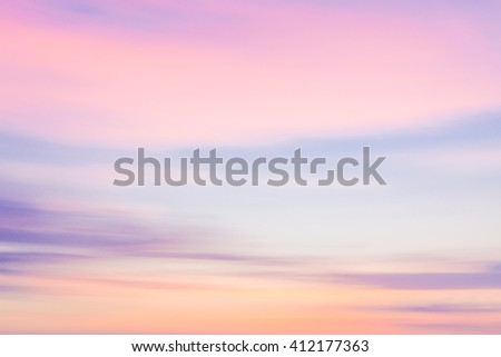 Defocused sunset sky nature background with blurred panning motion.