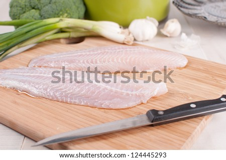 Defrosted fish fillets with vegetables horizontal