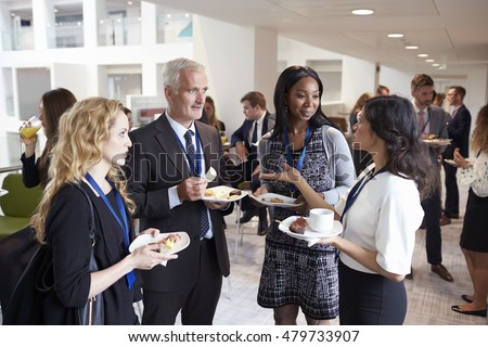 Delegates Networking During Conference Lunch Break