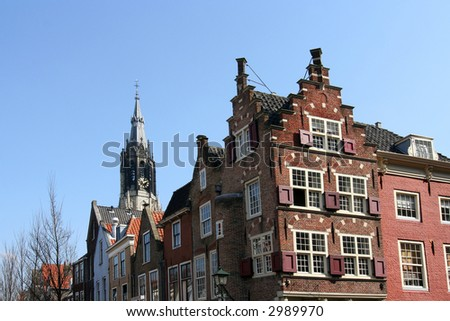 Delft historic houses with Dutch gables and church tower
