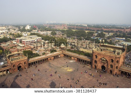 Delhi,India - February 24, 2016 :From the top of Jama Masjid #2 Shot was taken from one of the minar of mosque from where UNESCO World Heritage Red Fort can bee seen(Red Wall boundary).