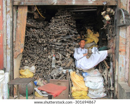 DELHI, INDIA - FEBRUARY 20, 2015: man waits in receiving point of scrap metal