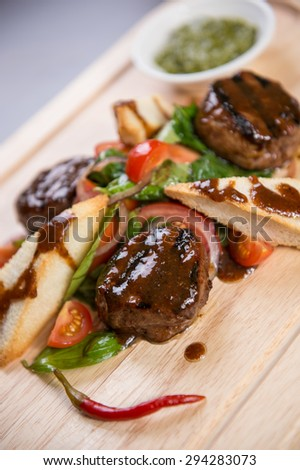 Delicious beef steak on wooden board, close-up