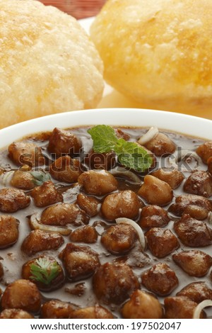 Delicious chole with bhatura in background, Indian food