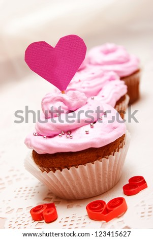 Delicious cupcake with pink cream close-up